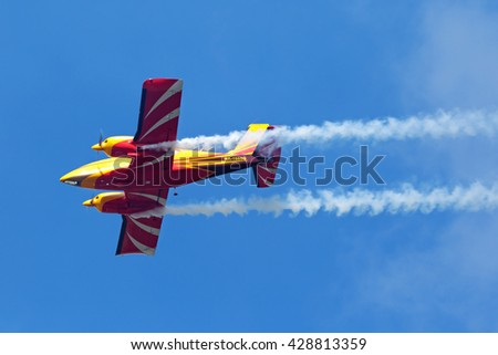 """ZHUKOVSKY, MOSCOW REGION, RUSSIA - AUG 29, 2015: A demonstration flight of the aerobatic team """"First flight"""" on Piper PA-23-250 plane at the International Aviation and Space salon MAKS-2015 - stock photo"""