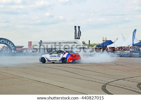 ZHUKOVSKY, MOSCOW REGION, RUSSIA - AUG 28, 2015: Drift show in the advertising of the manufacturer of tires Yokohama at the International Aviation and Space salon MAKS-2015 - stock photo