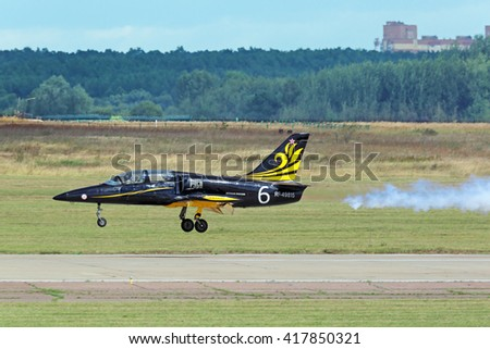 """ZHUKOVSKY, MOSCOW REGION, RUSSIA - AUG 30, 2015: Аerobatic team """"Rus"""" on Aero L-39 Albatros plane on the runway the airfield Ramenskoe at the International Aviation and Space salon MAKS-2015 - stock photo"""