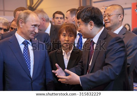 ZHUKOVSKY, MOSCOW REGION, RUSSIA - AUG 25, 2015: The President of the Russian Federation Vladimir Vladimirovich Putin with Chinese delegation at the International Aviation and Space salon MAKS-2015