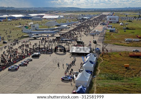 ZHUKOVSKY, MOSCOW REGION, RUSSIA - AUG 30, 2015: Visitors examine exhibits at the International Aviation and Space salon MAKS-2015, top view
