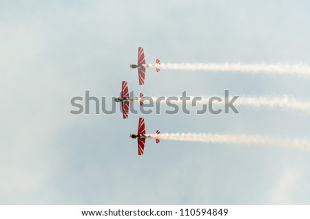 ZHUKOVSKY, MOSCOW REGION/RUSSIA - AUGUST 10: Aerobatic sport team First Flight on Yak-52 trainer aircrafts at airshow devoted to 100 anniversary of Russian Air Forces on August 10, 2012 in Zhukovsky. - stock photo