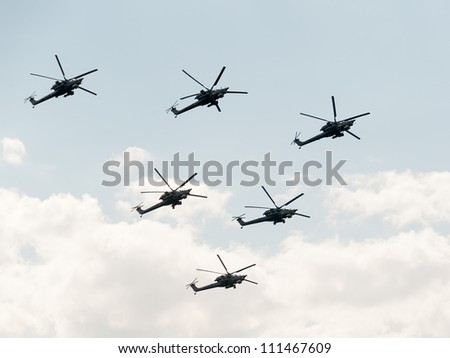 ZHUKOVSKY, MOSCOW REGION/RUSSIA - AUGUST 10: Aerobatic team Berkut on Mil Mi-28 (Havoc) attack helicopters. Airshow devoted to 100th anniversary of Russian Air Forces on August 10, 2012 in Zhukovsky. - stock photo