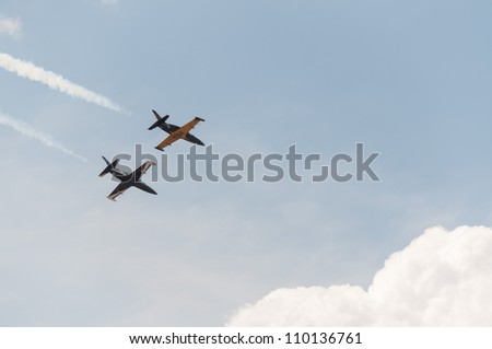 ZHUKOVSKY, MOSCOW REGION/RUSSIA - AUGUST 10: Aerobatic team Rus on Aero L-39 Albatros aircrafts in airshow devoted to 100th anniversary of Russian Air Forces on August 10, 2012 in Zhukovsky. - stock photo