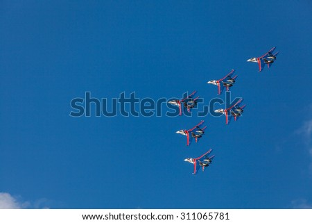 ZHUKOVSKY, MOSCOW REGION, RUSSIA - AUGUST 29, 2015: Aerobatic Team Russian Knights at WorldWide AirShow MAKS-2015 in Zhukovsky, Moscow region, Russia. - stock photo
