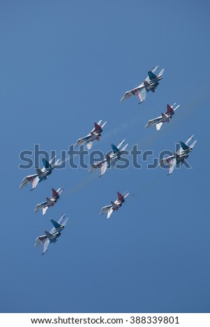 ZHUKOVSKY, MOSCOW REGION, RUSSIA - AUGUST 28, 2013: Aerobatic teams Swifts (Strizhi) on planes MiG-29 and Russian Knights on planes Su-27 at the International Aviation and Space salon MAKS-2013
