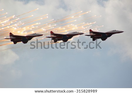Zhukovsky. Moscow region. Russia  August  28, 2015  International Aerospace Salon -2015 Three MiG-29 Swifts aerobatic team. - stock photo