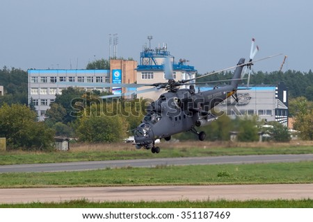 Zhukovsky, Moscow region, Russia - August 24, 2013: Russian combat helicopter Mil Mi-35 of the Russian Air Force takes off  in Zhukovsky during MAKS-2013 airshow. - stock photo