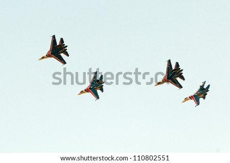 ZHUKOVSKY, MOSCOW REGION/RUSSIA - AUGUST 10: 4 Su-27 Flanker of The Russian Knights aerobatic team. Airshow devoted to 100th anniversary of Russian Air Forces on August 10, 2012 in Zhukovsky.