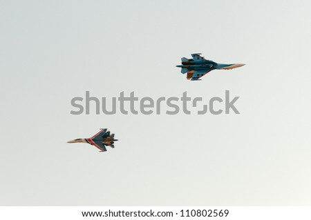 ZHUKOVSKY, MOSCOW REGION/RUSSIA - AUGUST 10: 2 Su-27 Flanker of The Russian Knights aerobatic team. Airshow devoted to 100th anniversary of Russian Air Forces on August 10, 2012 in Zhukovsky. - stock photo