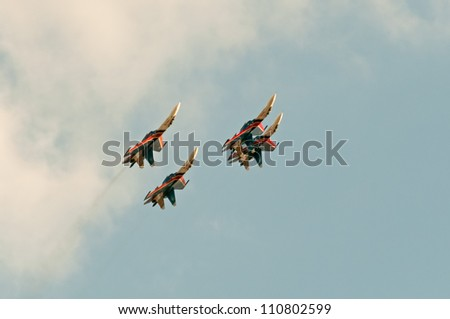 ZHUKOVSKY, MOSCOW REGION/RUSSIA - AUGUST 10: 4 Su-27 Flanker of The Russian Knights aerobatic team. Airshow devoted to 100th anniversary of Russian Air Forces on August 10, 2012 in Zhukovsky. - stock photo