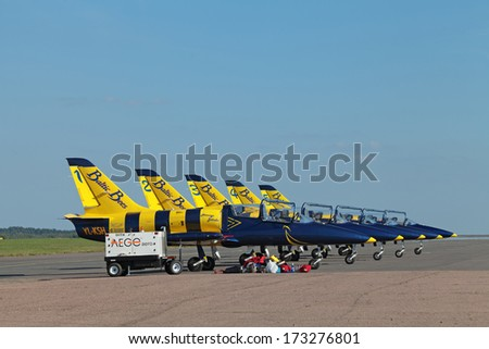 ZHUKOVSKY, RUSSIA - AUG 28, 2013: Aircraft aerobatic team Baltic Bees at the International Aviation and Space salon MAKS-2013. Parking aircraft Ramenskoye airfield - stock photo
