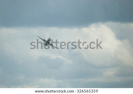 ZHUKOVSKY, RUSSIA - AUG 26, 2013: International aviation and space salon MAKS-2013. Flight of the new Russian passenger aircraft Sukhoi Superjet 100 - stock photo