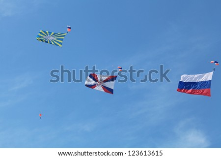 ZHUKOVSKY, RUSSIA - AUG 11: The opening ceremony of celebrating of the 100 anniversary of Russian air force. August, 11, 2012 at Zhukovsky, Russia. The paratroopers with flags in the sky