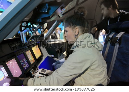 ZHUKOVSKY, RUSSIA - AUG 31, 2013: Visitors learn simulator aircraft at the International Aviation and Space salon MAKS-2013