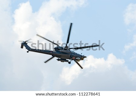 ZHUKOVSKY, RUSSIA - AUGUST 12: Mi-28N helicopter from Berkuty display team flies  during the celebration of the centenary of Russian Air Force on August 12, 2012 in Zhukovsky, Russia