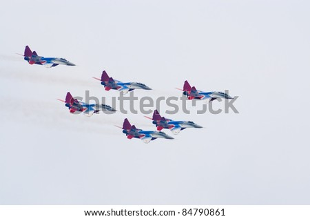 ZHUKOVSKY, RUSSIA - AUGUST 20: MiG-29 jets from Strizhi aerobatic display team fly in formation during MAKS-2011 airshow on August 20, 2011 in Zhukovsky, Russia