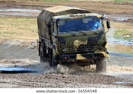 ZHUKOVSKY, RUSSIA - JULY 4: Russian truck Kamaz demonstrates its ability during a race at intermash July 4, 2010 in Zhukovsky, Russia.