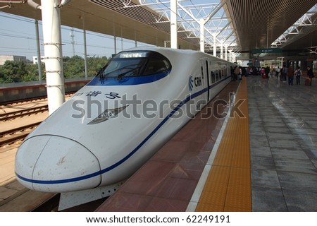 ZHUZHOU - HUNAN, CHINA - OCT 3:Modern train waits at platform on October 3, 2010 in ZhuZhou station. China invests in fast and modern railway, trains with speed over 340 km/h.