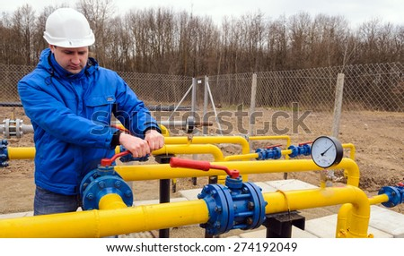 ZHYDACHIV, UKRAINE - APRIL 15: Worker employs equipment of the natural gas field station near western ukrainian city Zhydachiv, Ukraine on April 15, 2015 - stock photo