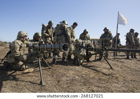 ZHYTOMYR REGION, UKRAINE - APRIL, 9, 2015: Mobilized soldiers pictured as they take part in military training and exercises near Zhytomyr - stock photo