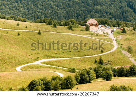 Zig-zag path and parting in the mountains - stock photo