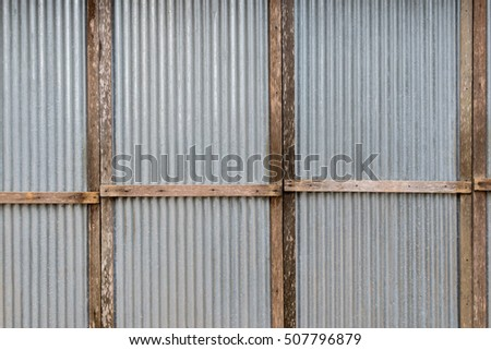 Zinc background, galvanized sheet with wooden structure.