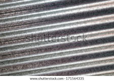 zinc galvanized corrugated metal texture diagonal and background - stock photo