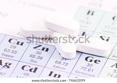 Zinc Pill on Periodic Table of Elements - stock photo
