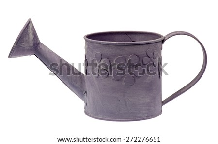 Zinc pot in the shape of watering can isolated. - stock photo