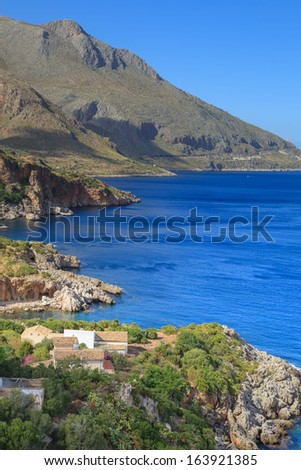 Zingaro Natinal Park - a view of a shore and houses, Sicily, Italy - stock photo