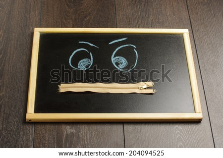 Zipped mouth concept quiet face drawing on the blackboard - stock photo