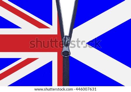 Zipped Scotland and United Kingdom flags referendum split - stock photo