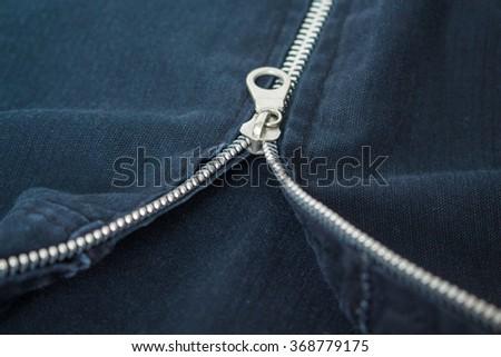 zipper clothing black jacket macro pattern background - stock photo