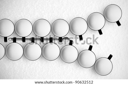Zipper made of mugs with milk and a spoon - stock photo