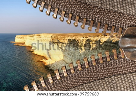 zipper of a camping tent with rocky landscape background - stock photo