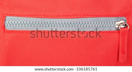 Zipper on a red background. Fastener. - stock photo