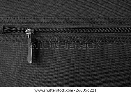 zipper on black material fabric - stock photo