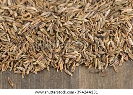 Zira or cumin - seeds on a wooden table