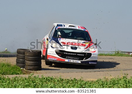 ZLIN,CZECH REP.-AUGUST 27. Driver Bouffier B. and co-driver Panseri X.with car Peugeot 207 S2000  at Barum Rally event,speed check Nr 2.August 27.2011 in Zlin,Czech republic - stock photo