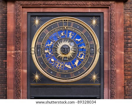 Zodiac clock on a building in city of London - stock photo