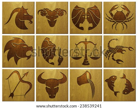 zodiac signs on wood - stock photo