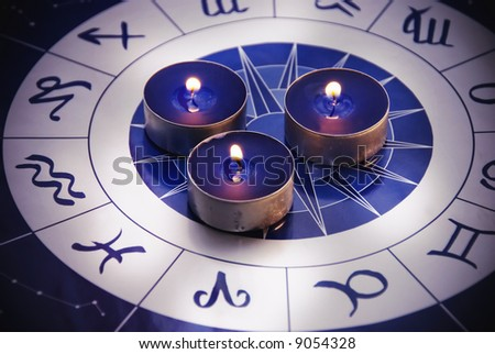 zodiac with three blue candles - stock photo