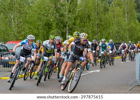ZOETERMEER, THE NETHERLANDS - JULY 19, 2015: Dutch national MTB championships. Start of the Elite mens group. - stock photo
