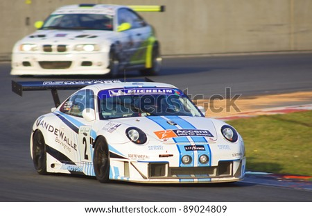 ZOLDER, BELGIUM- NOVEMBER 12: Frank THIERS, Hans THIERS, and Frederic VERVISCH in their winning Porsche Supercup during the 1000 km of Zolder Event on november 12, 2011 in Zolder, Belgium.