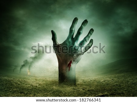 Zombie breakout - Contaminated Land with a zombie hand rising from the ground.. - stock photo