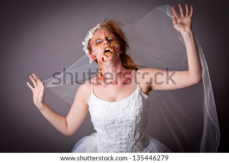 Zombie Bridal shoot woman in her veil - stock photo