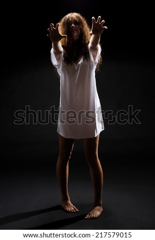 Zombie girl on black background - stock photo