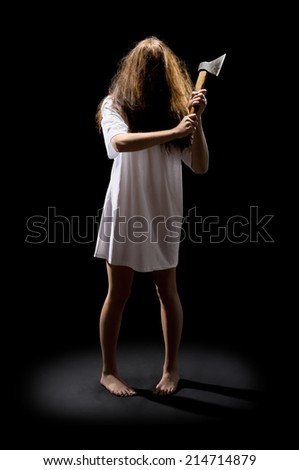 Zombie girl with axe on black - stock photo