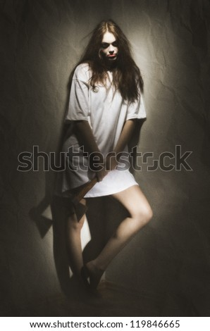 Zombie girl with old axe (ancient version) - stock photo